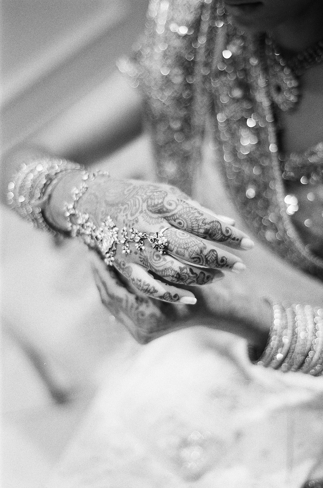indian bride getting ready henna on hands