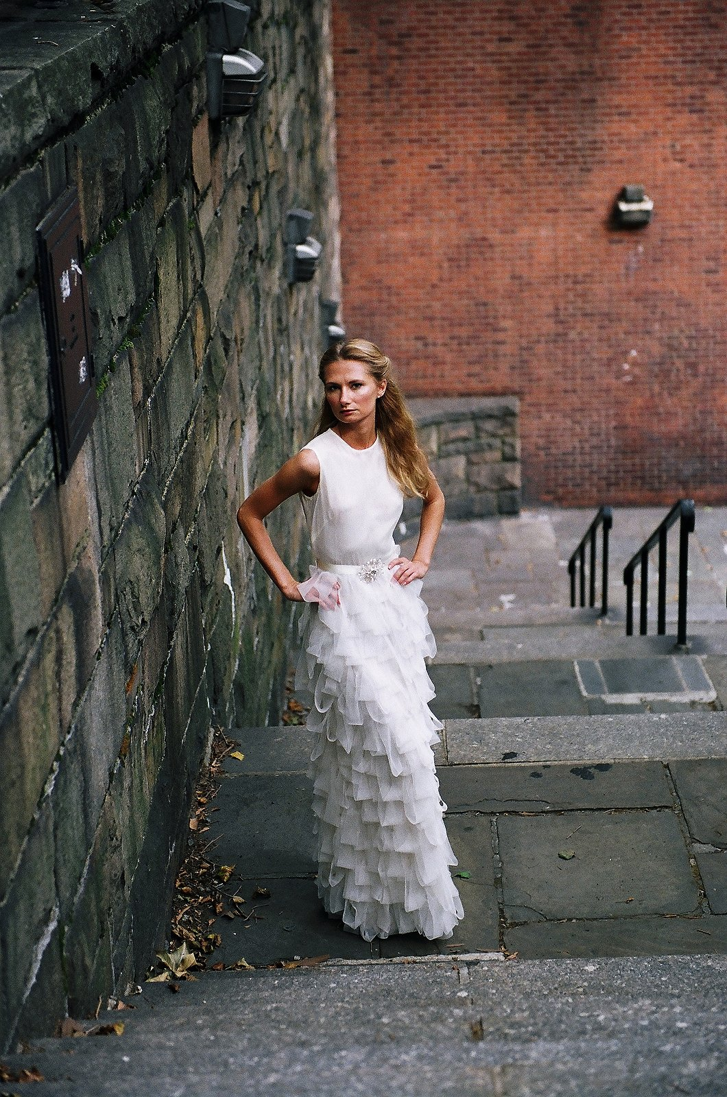 bridal portrait of bride standing on lower step
