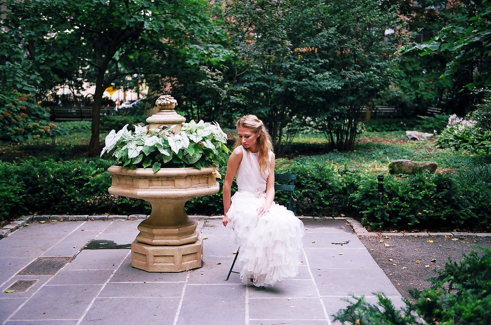 bridal portrait with bride seated in garden nyc