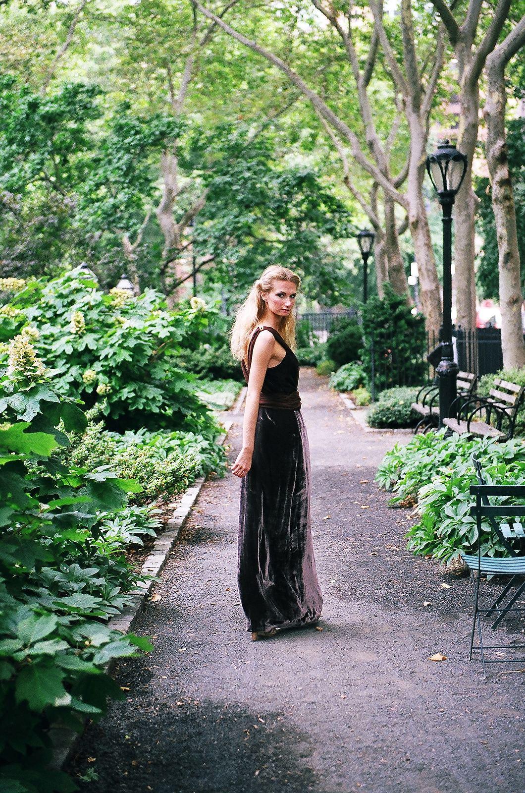 long dress with woman looking back at camera