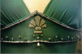 The hand embroidered design is based on Tessa's necklace.