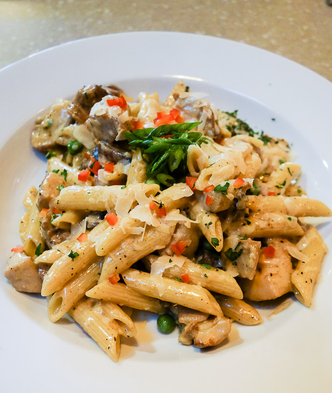 cajun food in downtown san diego, jambalaya pasta with creamy chicken in a bowl