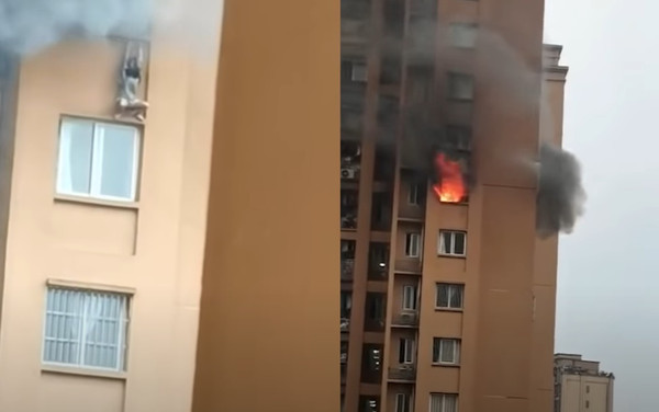 惊悚视频:高楼恐怖大火 姑娘爬窗躲避 失手坠楼