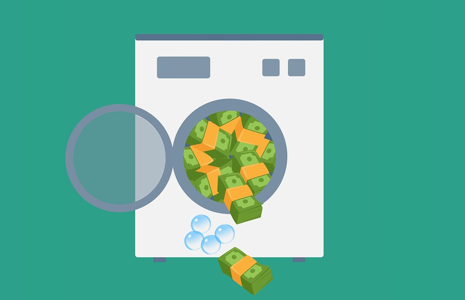 image showing a washing machine washing money as a sign of money laundering