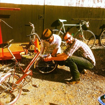 Ryan and Matt fixing a bike. Recording Ghost Notes - September 13-16, 2012