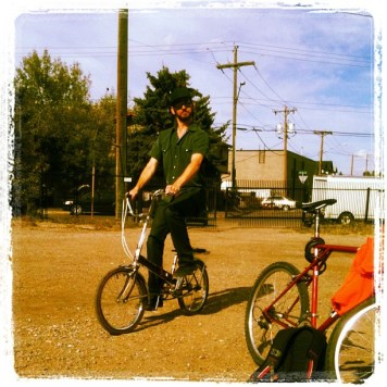 Mark Eadie rides a folding bike around the parking lot. Recording Ghost Notes - September 13-16, 2012