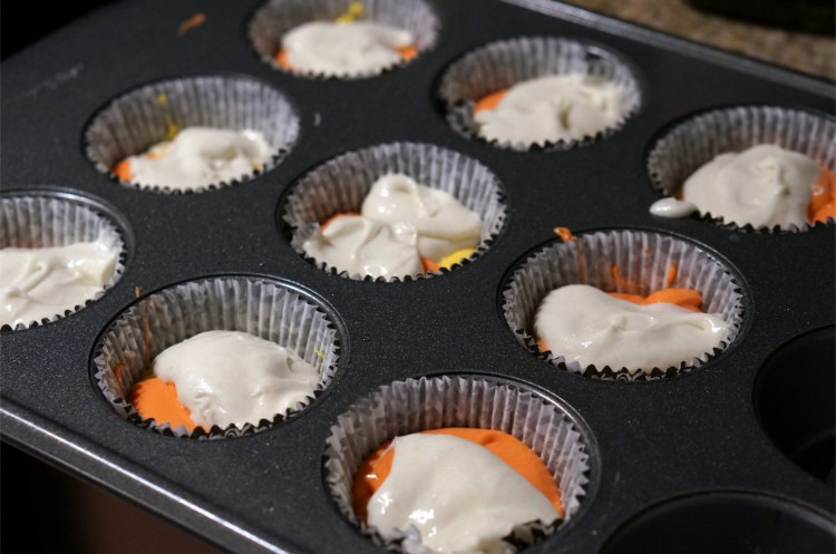 white yellow and orange cupcakes