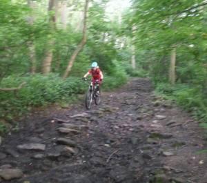 Elinor taking to the muddy rocks.