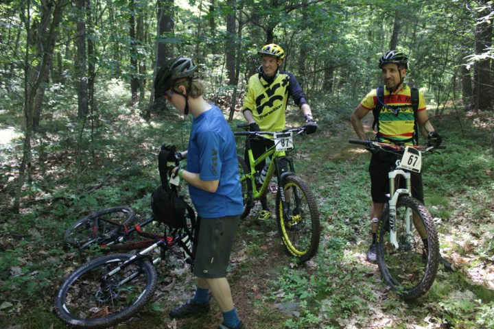 Between stages with my riding buddy, Garrett Payer (blue) who won his division. Not sure what I'm doing with my face. Photo by: Dan Kirkhus