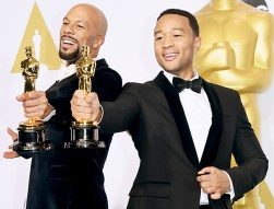 Oscar winners John Legend and Common proudly held up their Oscar statues after their Best Original Song win