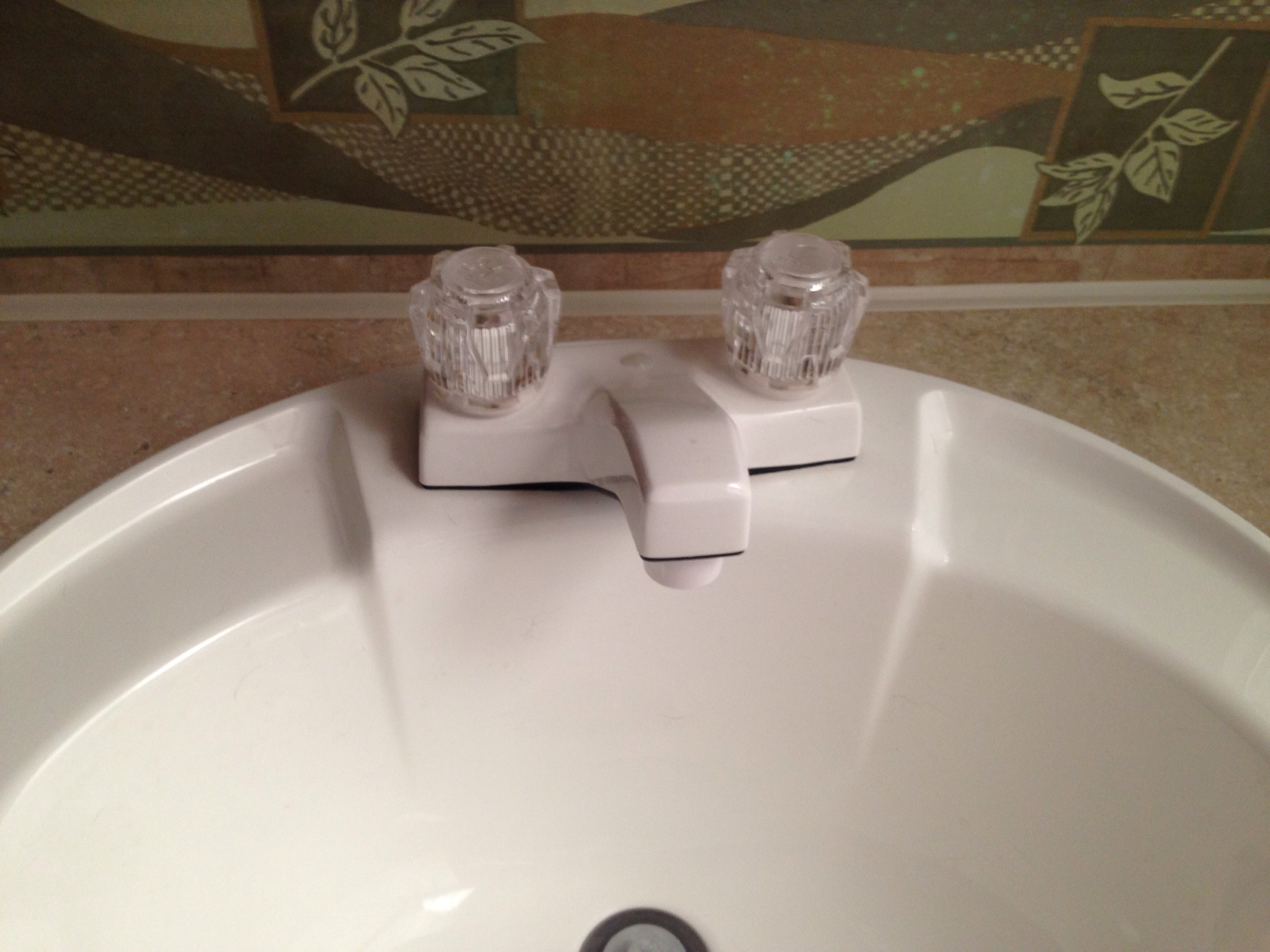 Replacing an RV Bathroom Faucet - We RV Do Hou