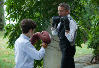 """GOTHAM: Alfred (Sean Pertwee, R) gives Bruce (David Mazouz, L) a lesson in fighting in the """"Harvey Dent"""" episode of GOTHAM airing Monday, Nov. 17 (8:00-9:00 PM ET/PT) on FOX. ©2014 Fox Broadcasting Co. Cr: Jessica Miglio/FOX"""