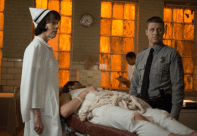 """GOTHAM: James Gordon (Ben McKenzie, R) accompanies a patient to the infirmary with Nurse Dorothy Duncan (guest star Allyce Beasley, L) in the """"Rogues' Gallery"""" episode of GOTHAM airing Monday, Jan. 5 (8:00-9:00 PM ET/PT) on FOX. ©2014 Fox Broadcasting Co. Cr: Jessica Miglio/FOX"""