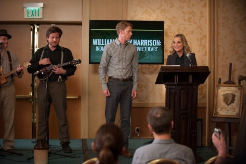 "PARKS AND RECREATION -- ""William Henry Harrison"" Episode 705 -- Pictured: (l-r) Timothee Baltz as Zach, Amy Poehler as Leslie Knope -- (Photo by: Colleen Hayes/NBC)"