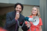 "PARKS AND RECREATION -- ""Save JJ's"" Episode 707 -- Pictured: (l-r) Jason Mantzoukas as Dennis Feinstein, Amy Poehler as Ron Swanson -- (Photo by: Colleen Hayes/NBC)"