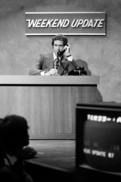 """SNL 40TH ANNIVERSARY SPECIAL -- Season 1, Episode 1 -- Pictured: Chevy Chase during """"Weekend Update"""" on October 11, 1975 -- (Photo by: Herb Ball/NBC)"""