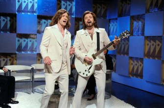 """SNL 40TH ANNIVERSARY SPECIAL -- Season 34, Episode 1552 -- Pictured: (l-r) Justin Timberlake as Robin Gibb, Jimmy Fallon as Barry Gibb during the """"Barry Gibb Talk Show"""" skit on May 9, 2009 -- (Photo by: Dana Edelson/NBC)"""