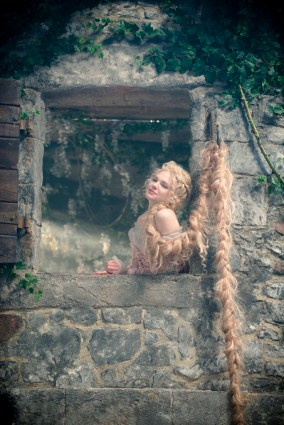 MacKenzie Mauzy stars as Rapunzel in INTO THE WOODS, a modern twist on beloved fairy tales. Based on the Tony?-winning musical and directed by Rob Marshall, the film hits theaters nationwide Dec. 25, 2014. Photo by: Peter Mountain. ? 2014 Disney Enterprises, Inc. All Rights Reserved..