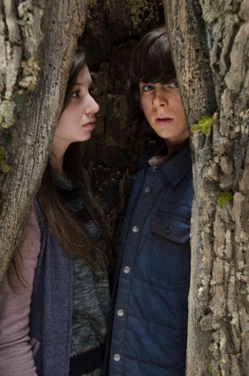 Chandler Riggs as Carl Grimes and Katelyn Nacon as Enid - The Walking Dead _ Season 5, Episode 15 - Photo Credit: Gene Page/AMC