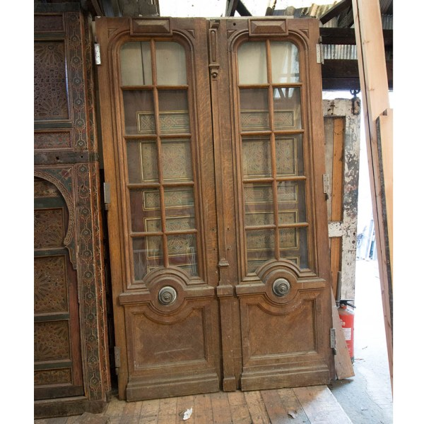 Pair of Oak doors with lions head handles