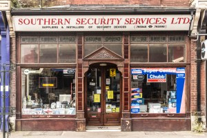 Buildings in Westbourne. Shop front of Southern Security Services, Poole Road, Westbourne