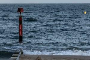Westbourne Beach - groyne and calm, blue sea.