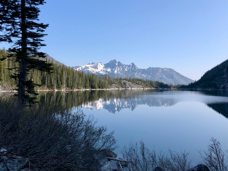 Mountain reflected in a calm alpine lake