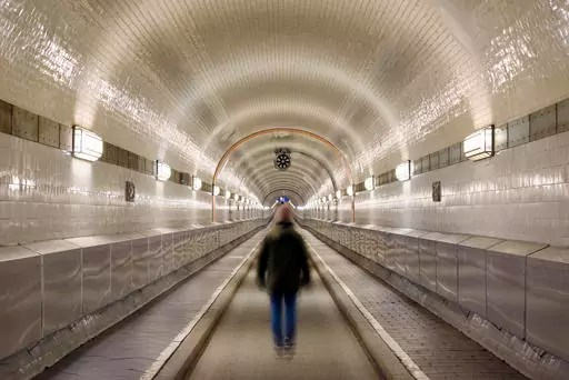 Germany, Hamburg, man walking in Old Elbe Tunnel