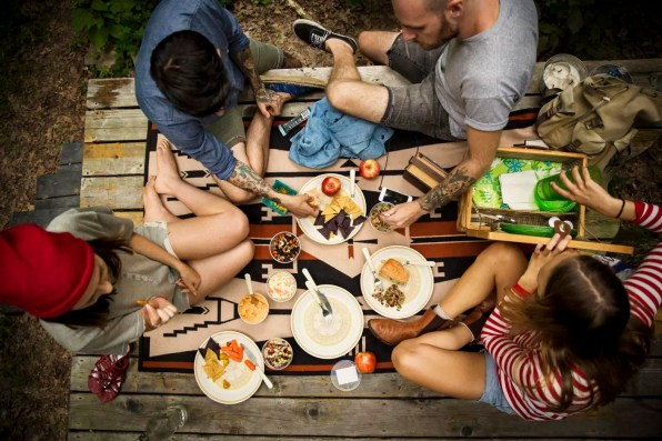 High angle view of friends having food while sitting on porch