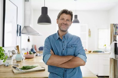 Mature man at home, looking confidet