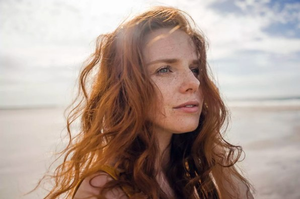Portrait of a redheaded woman on the beach
