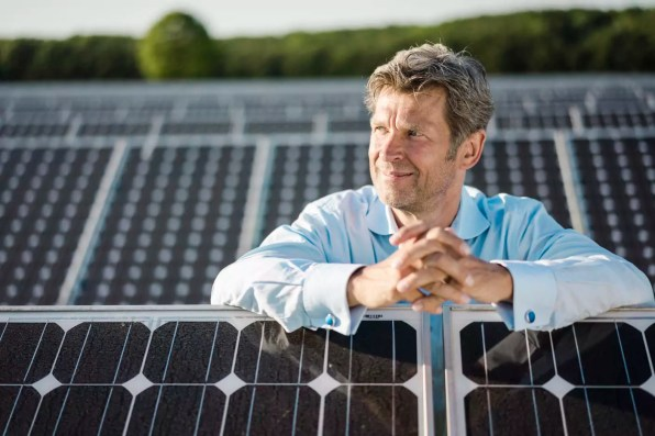 Mature man standing in solar plant