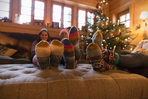 Family with colorful socks relaxing in Christmas living room