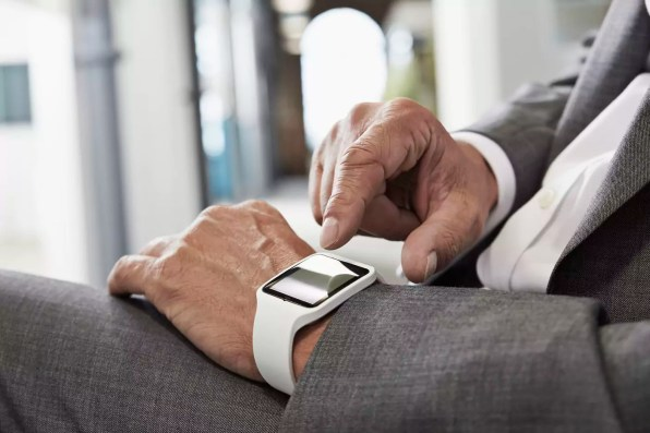 Businessman in office with smartwatch