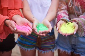 Holi colors in hands of women