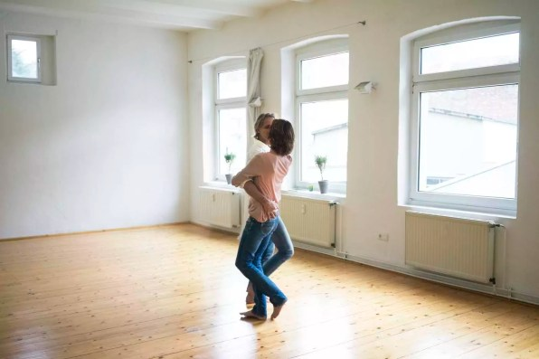 Mature couple dancing in empty room