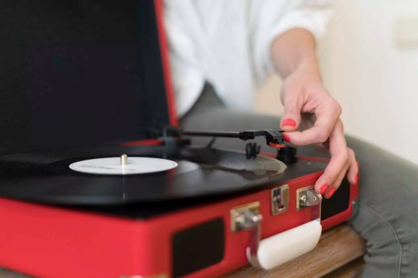 Woman using record player, close-up