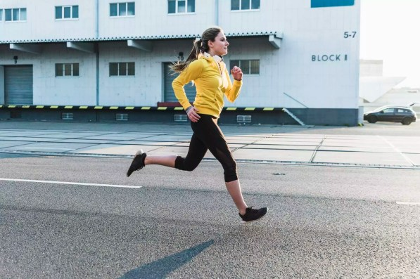 Young woman running on a street
