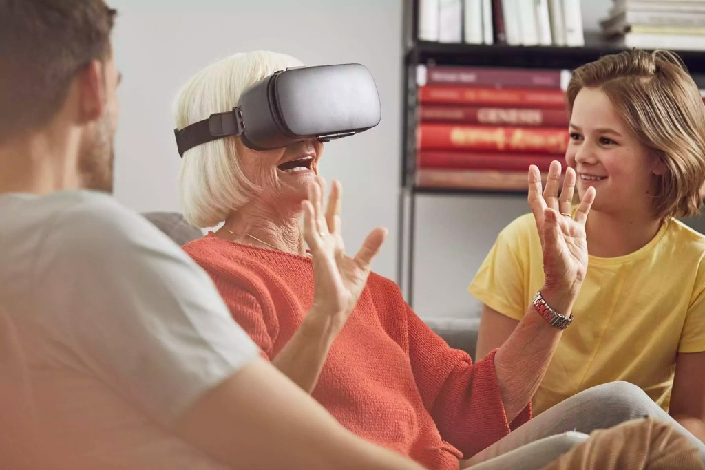 Grandmother using VR glasses with her grandsons - MCF00257