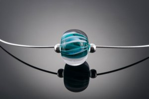 "Becky Congdon ""Aqua Teal Twist Omega"" handmade flamework glass bead/sterling silver 18"" length $95. SOLD (photo by Ann Cady)"