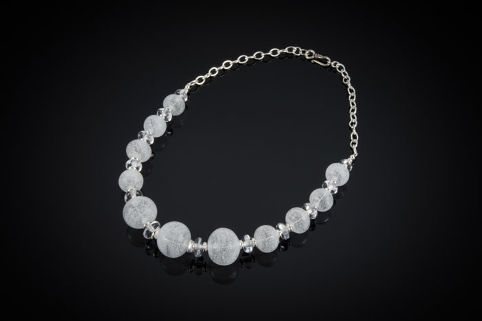 """Becky Congdon """"Classy Ice Necklace"""" 21"""" handmade flameworked glass hollow and solid beads w/ sterling silver accents $300. SOLD (photo by Ann Cady)"""