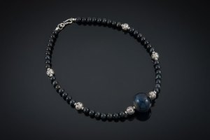"Becky Congdon ""Jazz Necklace"" 20.5"" handmade flamework glass hollow bead with blue tigers eye gemstone beads and sterling silver (photo: Ann Cady) $180."