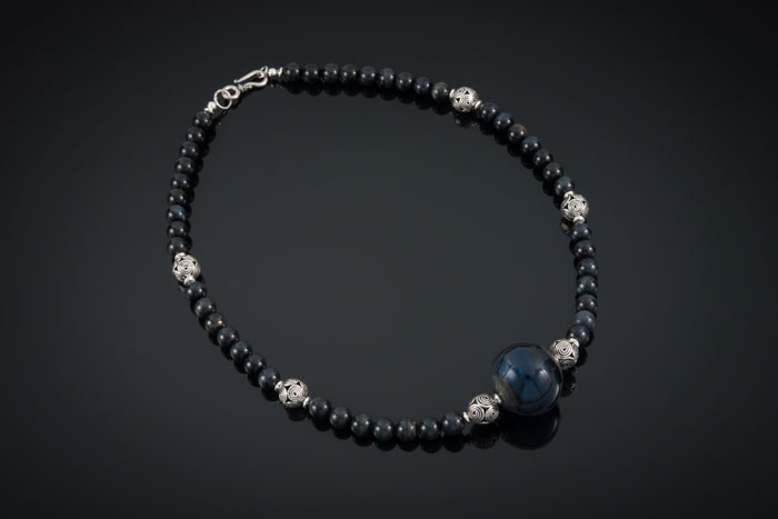 """Becky Congdon """"Jazz Necklace"""" 20.5"""" handmade flameworked glass hollow bead with blue tigers eye gemstone beads and sterling silver (photo by Ann Cady) $180. SOLD"""