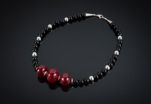 """Becky Congdon """"Snap, Crackle, Pop! Necklace"""" 21.5"""" handmade flamework glass hollow red beads with sterling silver and onyx gemstone beads (photo: Ann Cady) $225.SOLD"""