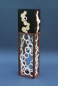 "Tracy Fiegl ""Temporal Effervescence"" 66x18x12 Macassar ebony/English sycamore veneer, walnut and maple $6,000."