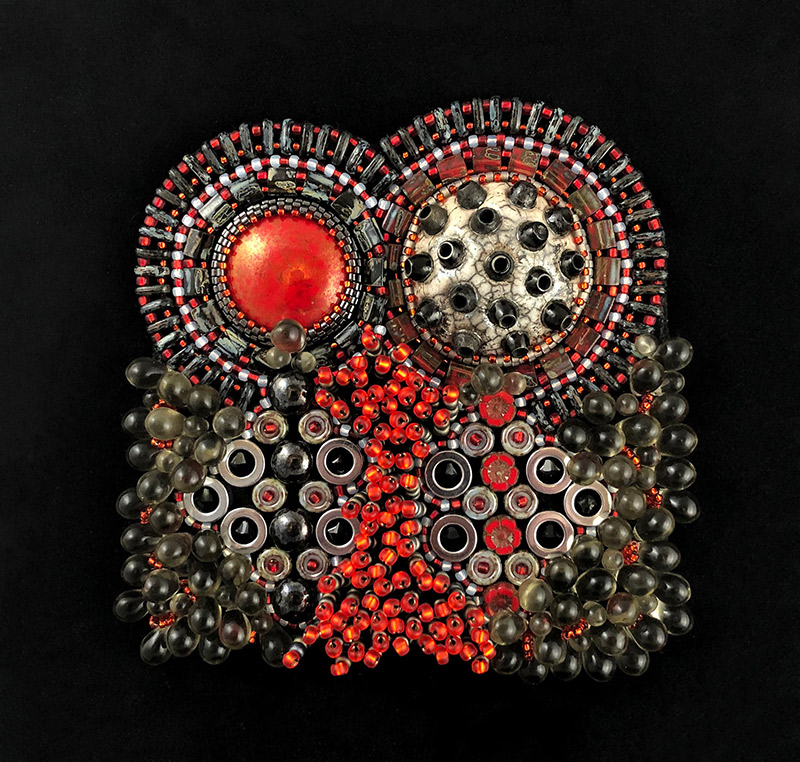 "San Fortune ""Barbute"" 3.5x3.5 bead embroidery on framed black panel raku focal, red pottery focal, black Swarovski bicone crystals, red glass flowers, glass seed beads, glass tila beads, glass grey teardrops $280."