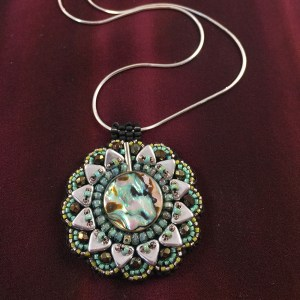 "San Fortune ""Abalone Pendant"" 18"" sterling silver chain with abalone shell, Miyuki glass seed beads, 6mm triangle beads, Swarovski crystals $80."