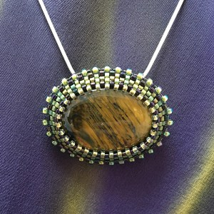 "San Fortune ""Tigereye Pendant"" bead embroidery w/ 18"" sterling chain $85."