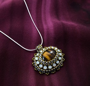 "San Fortune ""Tiger Eye Pendant with Yellow"" (View B) Tiger Eye, yellow crystal cup chain, glass seed bead bezel, various glass seed beads, 18"" sterling silver snake chain $85."