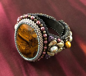"San Fortune ""Tiger Iron Cuff"" tiger iron focal, glass seed beads, 2 faceted tiger eye beads $200. SOLD"